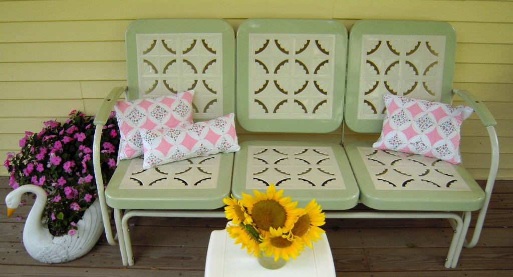 You can't get much cuter cottage style than this! I bought my mom this repro glider for our family cottage a few years back. Every year she plants pink impatients in these vintage swan containers. I whipped up these adorable shabby chic pillows from a gorgeous hand sewn quilt, they'll be available soon in my vintage shop! And what's summer without a bouquet of sunflowers!