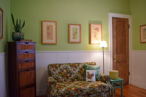 This is how the room functioned for quite some time. Color reduction prints, a cute floral loveseat that pulled out into a twin bed, file cabinet, and the other side had an awesome mid century chair and mini credenza. See the Apartment Therapy tour for the whole thing. Link bottom of page.