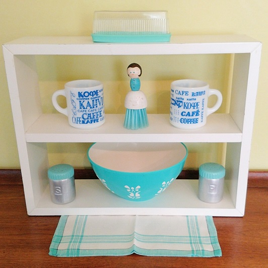 Fave vintage: aqua plastic butter dish, milk glass coffee mugs, cute lady brush, aqua topped aluminum shakers, Regaline plastic bowl, anchored on a napkin. Mugs available in the vintage shop, the other items are from my personal collection.