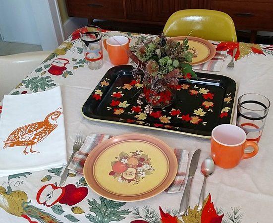 Fave vintage: awesome fall tablecloth, melmac plates, orange milk glass mugs, striped glasses, vintage napkins, leaf tray, dried florals, and an artgoodies quail tea towel.