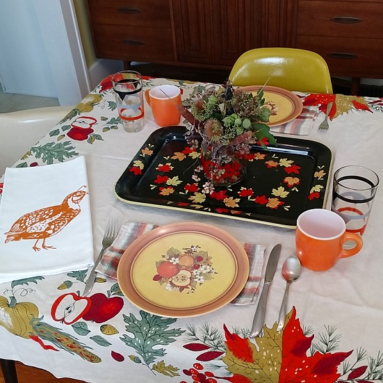 Fave vintage: awesome fall tablecloth, melmac plates, orange milk glass mugs, striped glasses, vintage napkins, leaf tray, dried florals, and an artgoodies quail tea towel.