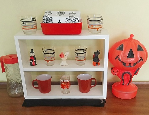 Fave vintage: striped glasses from Brazil, orange casserole/fridgie, Halloween Gurley candles, Tang pitcher, pyrex mugs, juice glass, Halloween blow mold, artgoodies oak leaf towel up top, anchored by a black, probably mourning, hankie.